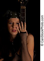 music - Beautiful woman with electro guitar