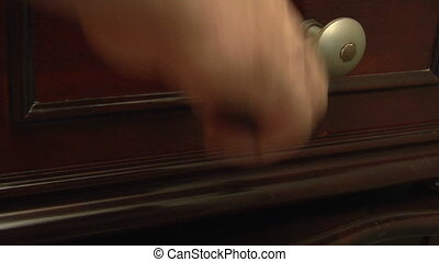 music box crank - This is a close up shot of a hand cranking...