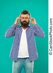 music. brutal caucasian hipster with moustache. Happy man hipster listen to music. Bearded man. Hair and beard care. Man in earphones. Young and brutal. Mature hipster with beard. e book education