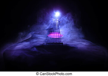Music concept. Acoustic guitar isolated on a dark background...