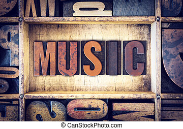 """The word """"Music"""" written in vintage wooden letterpress type."""