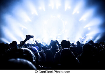 Music concert, many people enjoying evening in night club,...