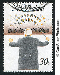 Music Conductor - NEW ZEALAND - CIRCA 1986: stamp printed by...