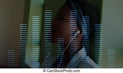 Music equalizer over woman wearing headphones