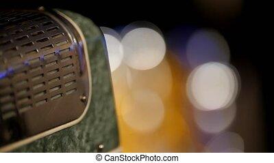 Music equipment at rock concert - guitar amplifier, close up, telephoto