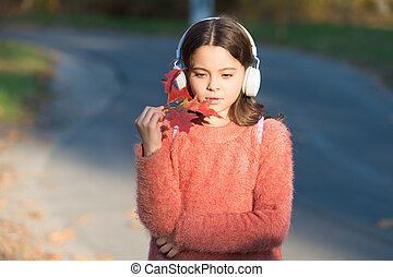 Music for autumn cozy mood. Listening songs. Melody for good mood. Drive by song. Enjoy music outdoors fall warm day. Audio file. Kid girl relaxing autumn leaf with modern wireless headphones