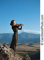 Music for eternity - Girl in concert dress, playing the...