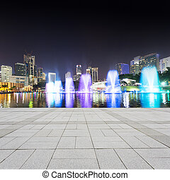 music fountain in the square of KLCC at night, kuala lumpur.