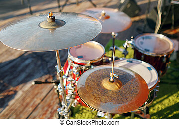 Music in the park, drums on background wooden floors
