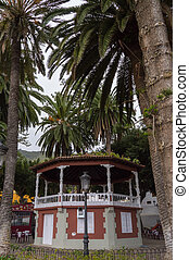 Music kiosk between palm trees on the island of Tener