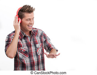 Music listening to the music. Handsome young man in headphones listening to the music and gesturing while isolated on white