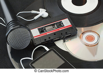 Music - Microphone, vinyl discs, audiotape, mp3 player, cd...