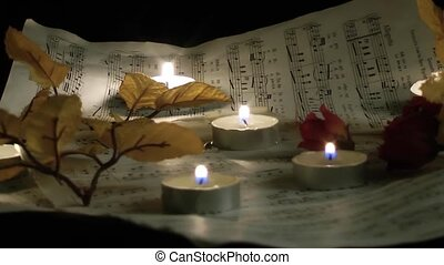 Music Notes Sheets and Candles