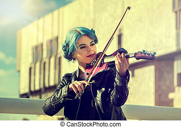 Music on violin by woman perform in park outdoor.