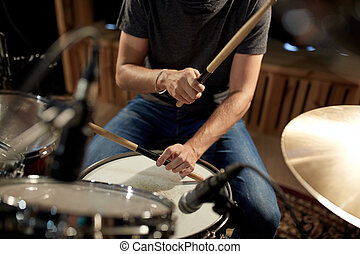 male musician playing drums and cymbals at concert - music, ...