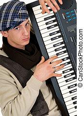Music performer, keyboard - Handsome alternative dressed...