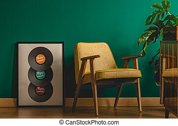 Music poster next to armchair