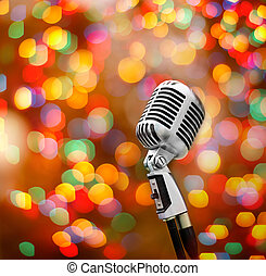 Music show - old vintage microphone with a color lights...