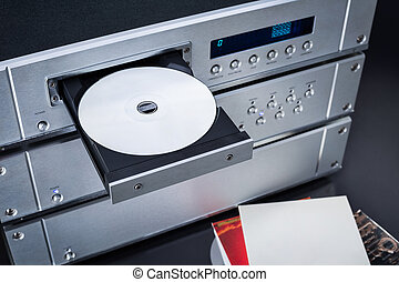 Music Stereo Audio Compact Disc CD Player with Amplifier rack.