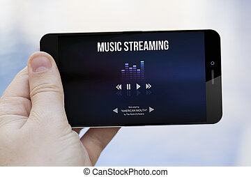 delivery technology concept: hand holding a 3d generated smartphone showing music streaming app. Screen graphics are made up.