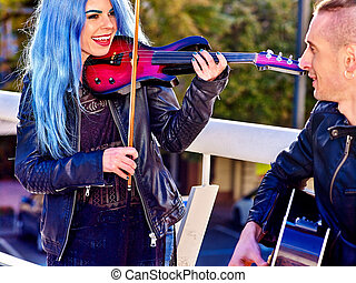 Music street performers with girl violinist