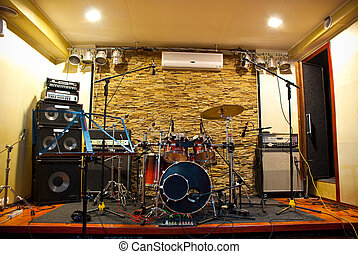 music studio with drums and amplifiers