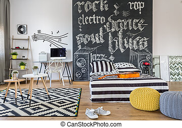Music themed bedroom - Shot of a black and white bedroom of...