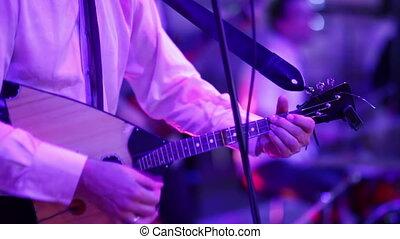 Musician playing the balalaika - musical band performs on...