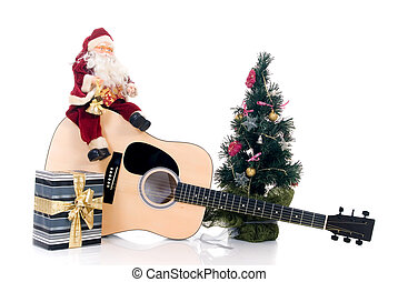 Musical Christmas - Christmastree with Santa Claus sitting...