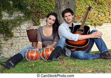 Musical couple in filed