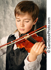 musical education - Freckled nine year old boy playing the...