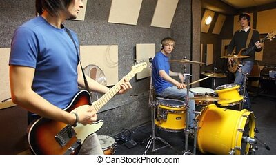 musical group of three persons in studio