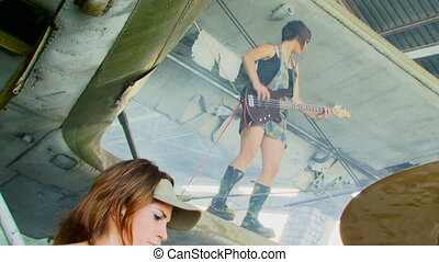 Musical idea - A group of girls playing a musical instrument...