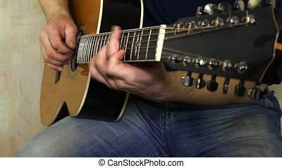 Musical instrument with guitarist hands