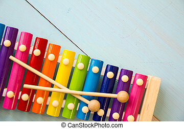 Musical instruments baby toyson wooden background. copy space, place for your text or slogan. Top view