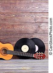 Musical instuments on vintage wooden background.