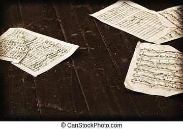 Musical notes strewn on the floor