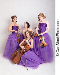 musical quartet in evening dresses