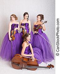 quartet in evening dresses