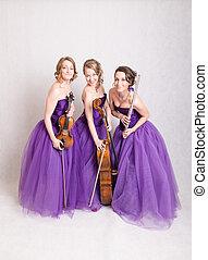 musical trio in the studio