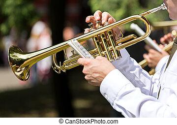 Musician blowing trumpet
