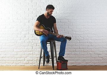 Musician concept - Attracive caucasian man in casual...
