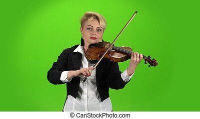 Musician girl plays the violin composition. Green screen -...