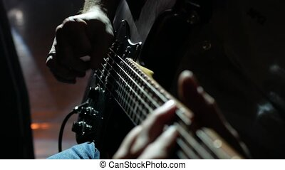 Musician , guitarist playing electric guitar. Close up.