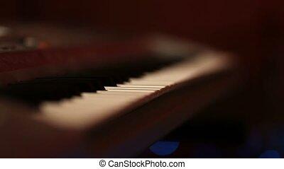 Musician hands on piano keyboard