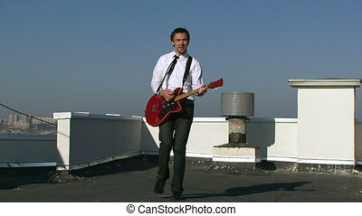 Musician in a suit playing a guitar - A musician plays...