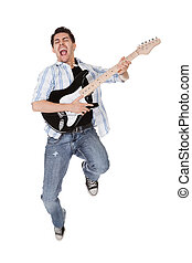 Musician jumping - Young musician jumping with his guitar. ...