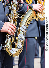 musician of military orchestra plays his saxophone