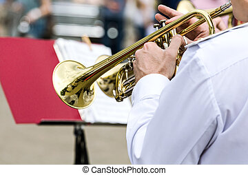 musician of military orchestra plays his trumpet