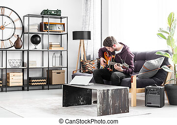 Musician on black couch